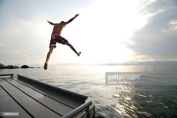 Man jumping off dock.