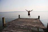 Man jumping off dock