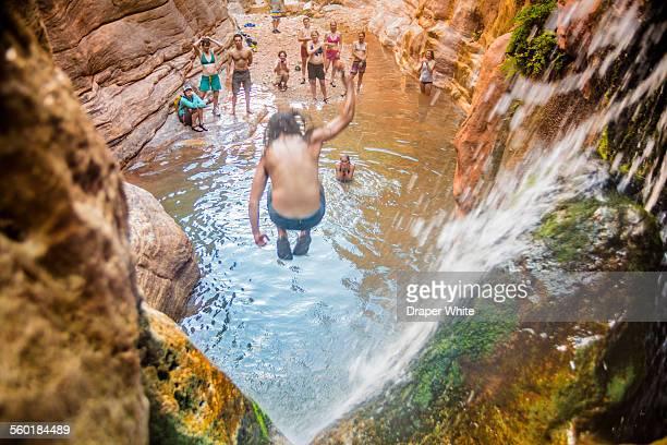 Man Jumping off Waterfall