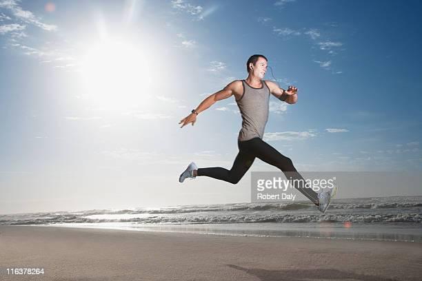 Man jumping on beach