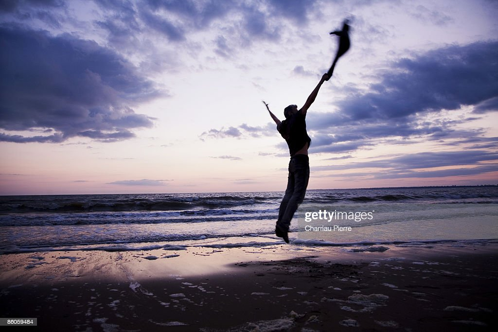 Man jumping on beach : Stock Photo