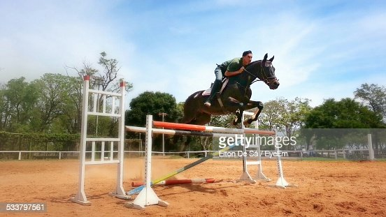 Man Jumping On Horse