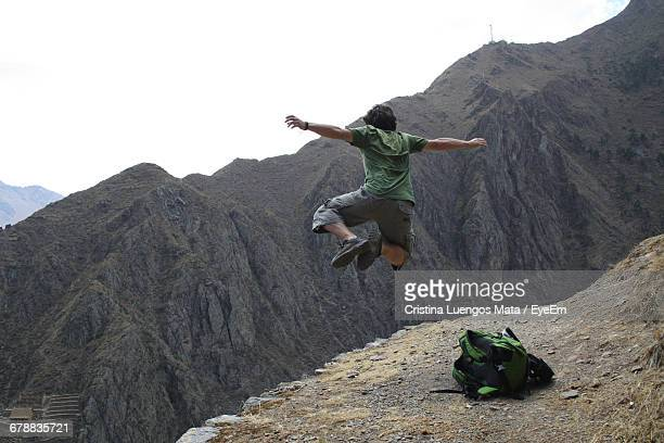 Man Jumping On Mountain