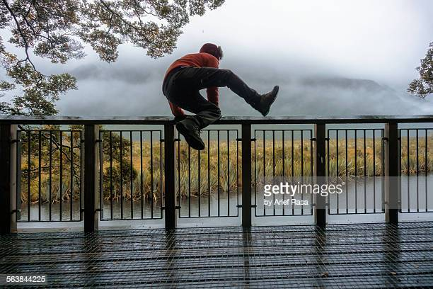 Man Jumping Over Fence