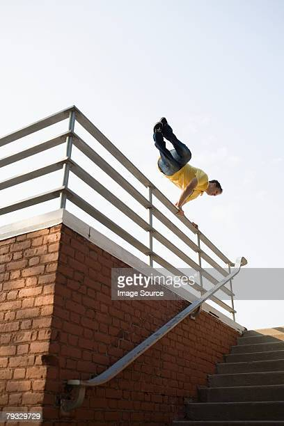 A man jumping over railings