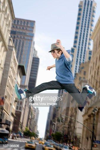 Man jumping over traffic