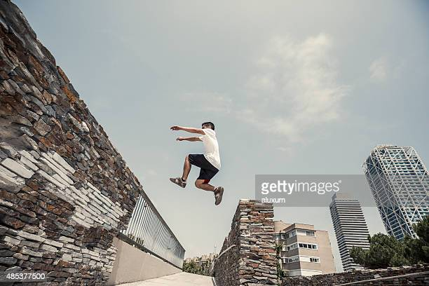 Man jumping practicing parkourin Barcelona Spain