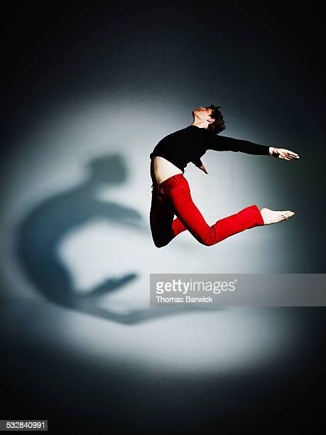 Man jumping with arms and legs outstretched