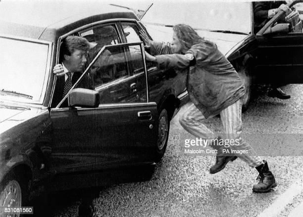 A man jumps in front of the car carrying the Princess of Wales as she arrived at Barrow shipyard to launch Britain's first Trident nuclear submarine