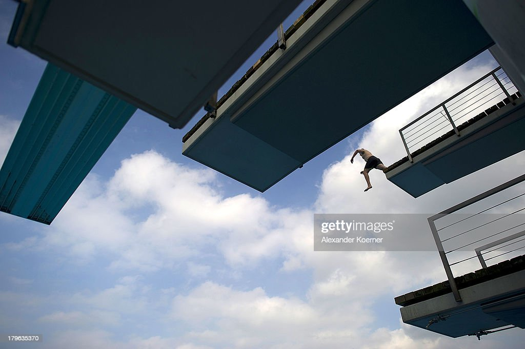 A man jumps into a pool early in the morning at Lister Bad on September 6, 2013 in Hanover, Germany. Weather forecast predicts temperatures with heights of 30 Celsius for the weekend accross Germany.