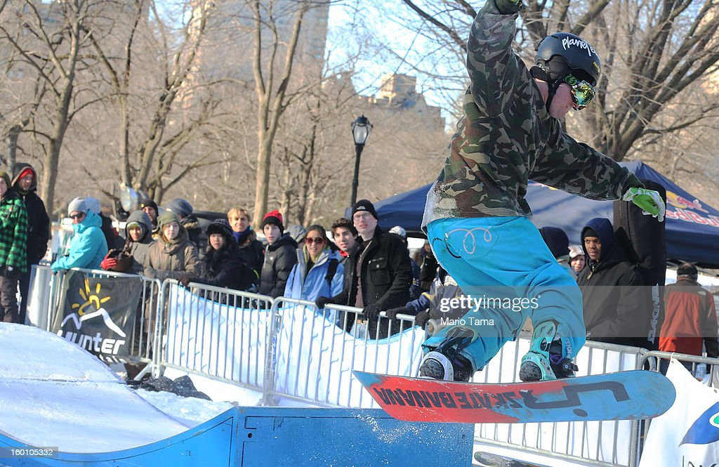 A man jumps on a snowboard at the Winter Jam in Central Park on January 26, 2013 in New York City. The annual festival brings skiing, snowboarding and snowshoeing to New Yorkers with free equipment.