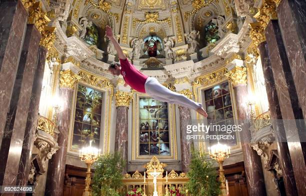 TOPSHOT A man jumps on the trampoline during a service in the Berlin Cathedral on June 5 2017 in Berlin / AFP PHOTO / dpa / Britta Pedersen / Germany...