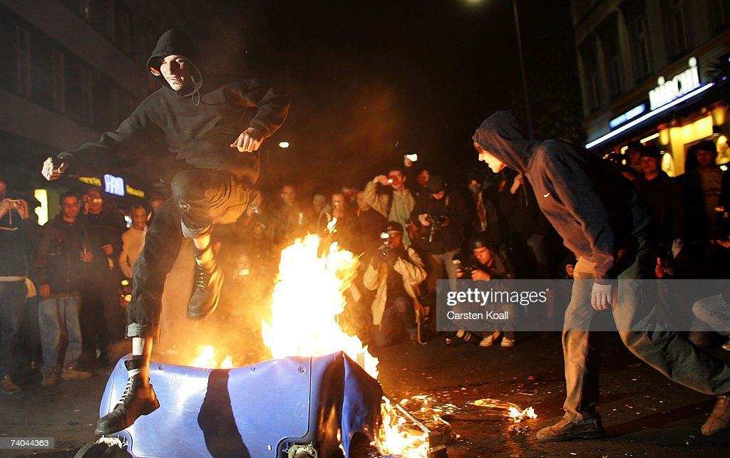 A man jumps over a fire set by demonstrators during clashes between mostly leftwing protesters and police on May Day in the district of Kreuzberg May...