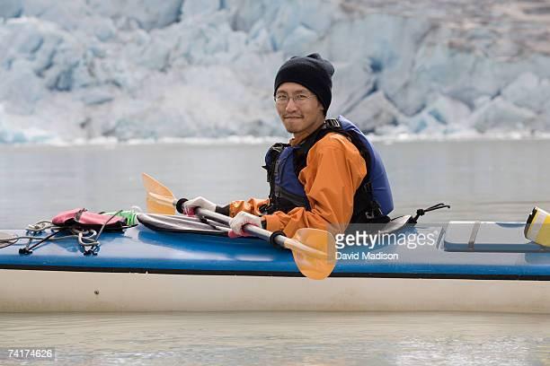 'Man kayaking, portrait'