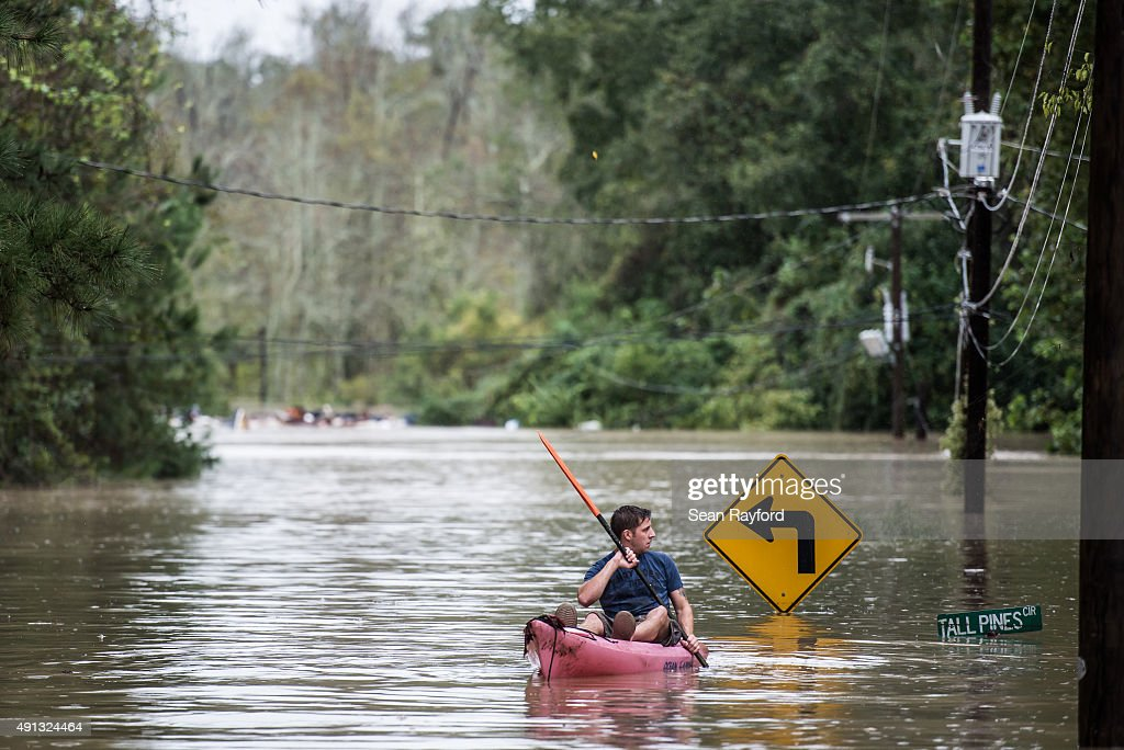 A man kayaks on Tall Pines Circle October 4 2015 in Columbia South Carolina South Carolina experienced a record rainfall with at least 115 inches...