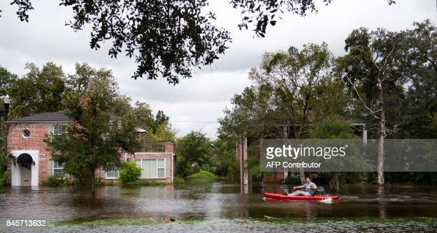 A man kayaks through the flooded streets of the San Marco historic district of Jacksonville Florida on September 11 after storm surge from Hurricane...