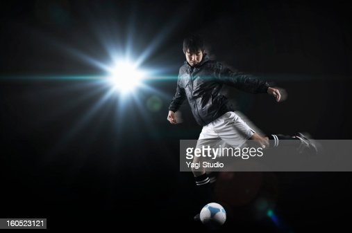 Man kicking a soccer ball : Stock Photo