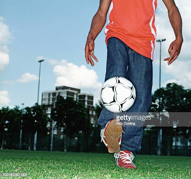 Man kicking football outdoors (blurred motion)