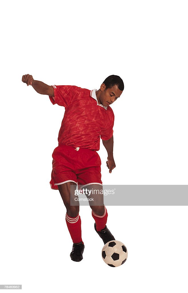 Man kicking soccer ball : Stock Photo