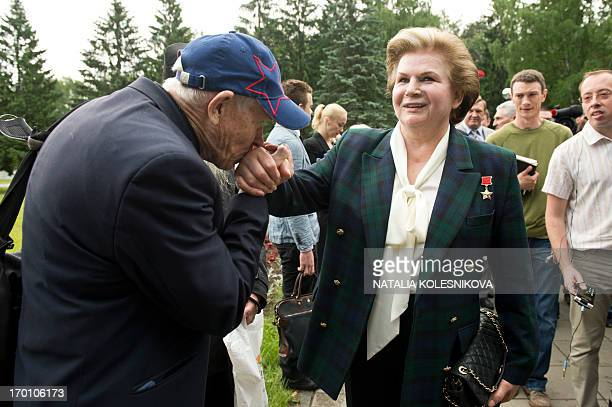 A man kisses hand of Soviet cosmonaut the first woman in space Valentina Tereshkova as hse walks in Star City outside Moscow on June 7 2013 AFP PHOTO...
