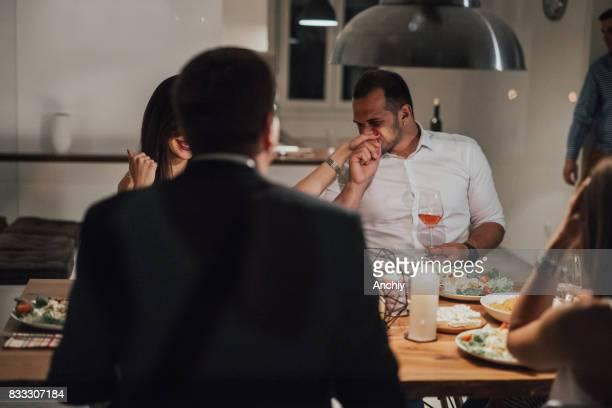 A man kisses his girlfriend's hand.