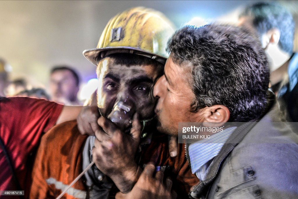 A man kisses his son rescued of the mine on May 13 2014 after an explosion in a coal mine in Manisa At least 157 miners were killed in collapsed coal...