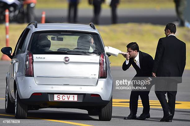 A man kisses Pope Francis's ring as he leaves aboard a small car the Mariscal Sucre international airport in Quito on July 5 2015 Pope Francis...