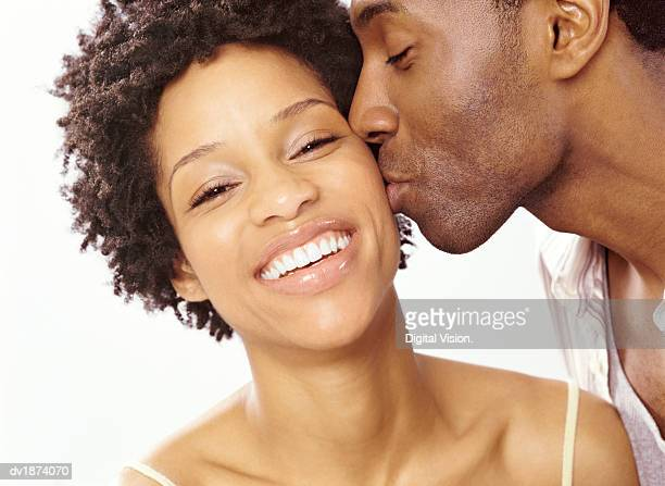 Man Kissing a Woman on the Cheek