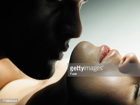 Man Kissing a Woman