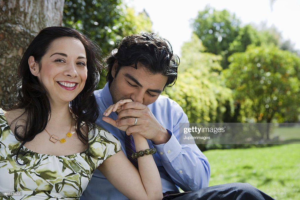 Man kissing hand of woman : Stock Photo