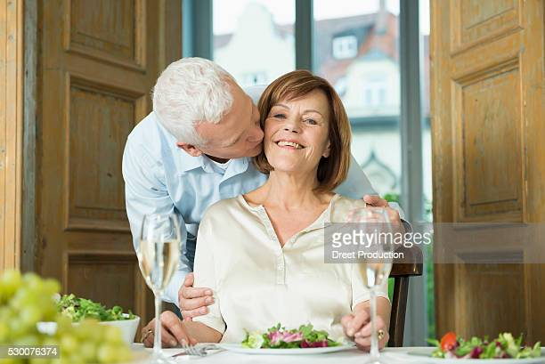 Man kissing his wife, smiling