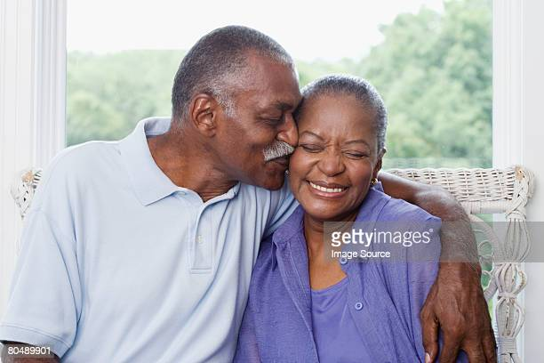 Man kissing wife