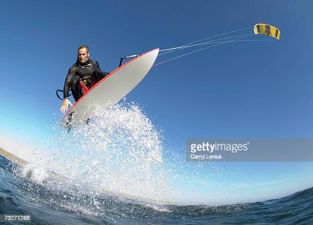 Man kiteboarding, low angle view
