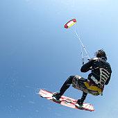 man kiteboarding, mid-air