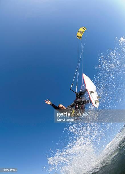 Man kiteboarding on sea