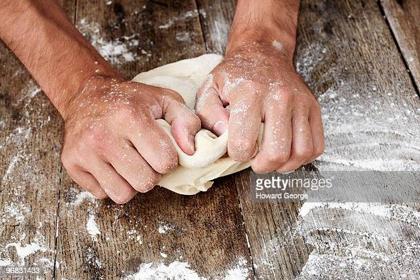 Man kneading bread dough