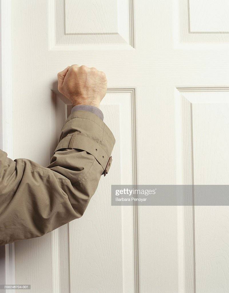 Man knocking on door, (Mid section) : Stock Photo