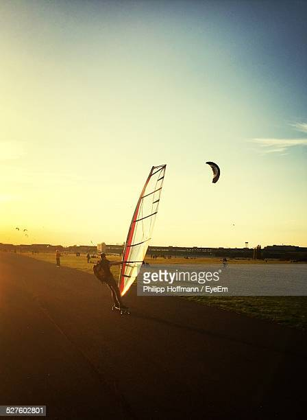 Man Land Sailing On Street Against Sky During Sunset