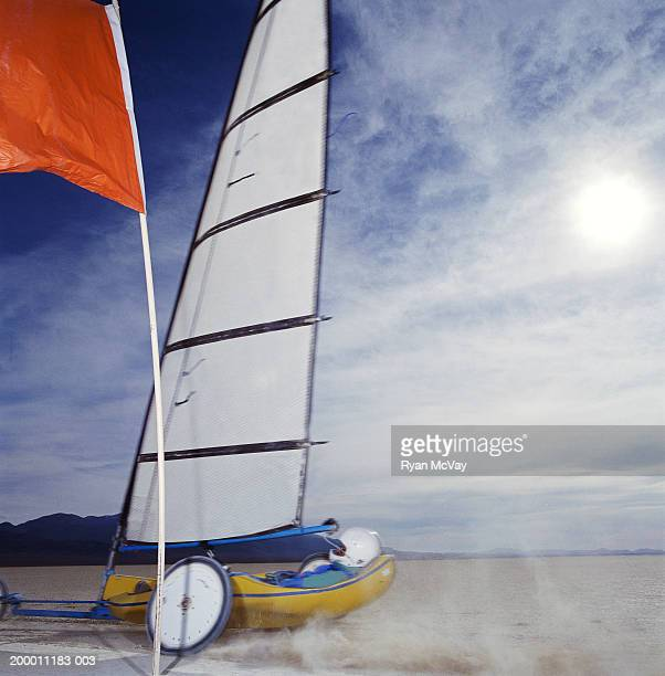 Man land yachting on dry lake bed, side view, Smith Creek, Nevada, USA