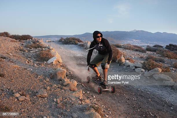 Man landboarding in desert environment