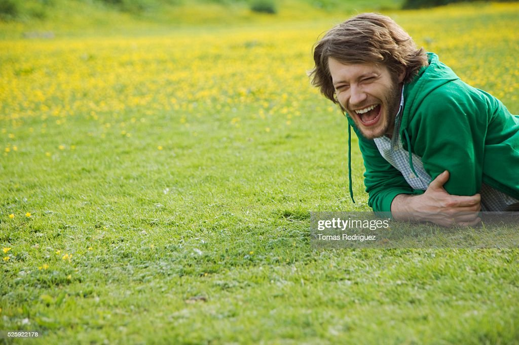 Man Laughing in a Meadow : Stock Photo