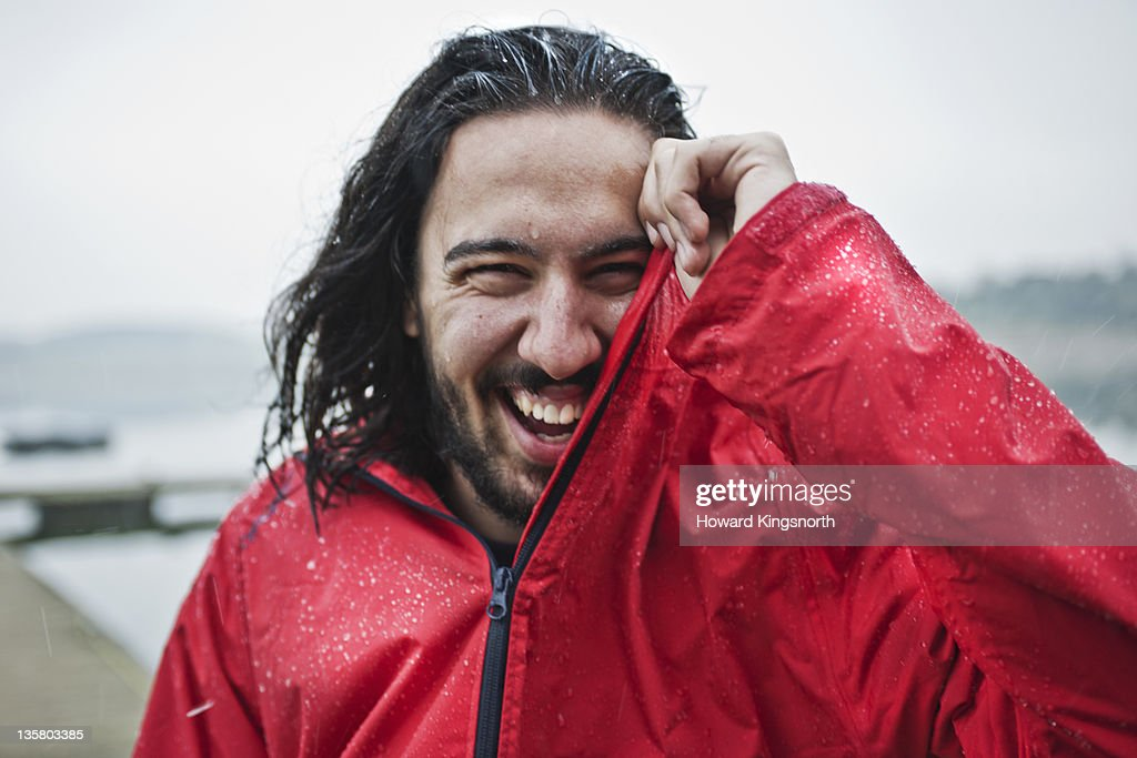 man laughing in the rain, portrait : Stock Photo