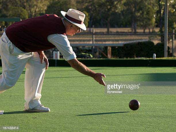 Man lawn bowling on sunny day