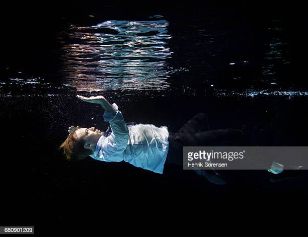Man laying in water