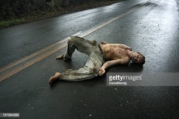 Man Laying On Road