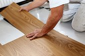 Man laying professional PVC-floor, close up