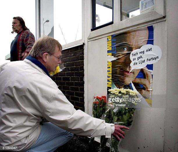 A Man Lays Flowers At The Office Of Controversial Dutch RightWing Politician Pim Fortuyn's Lijst Fortuyn Party May 6 2002 In Rotterdam Fortuyn Was...