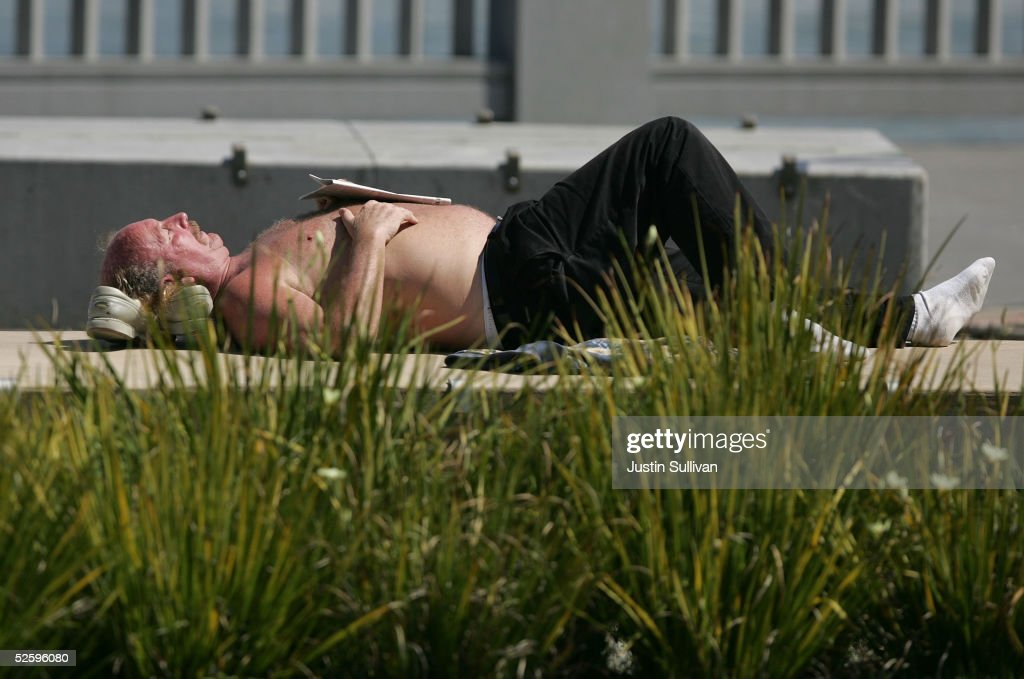 A man lays out in the sun along the Embarcadero April 6, 2005 in San Francisco. According to a study released Tuesday, almost 53 percent of Californians over 25 are overweight, and more than 17 percent are obese, or extremely overweight and are costing nearly $21.7 billion a year in medical bills, injuries and lost productivity.