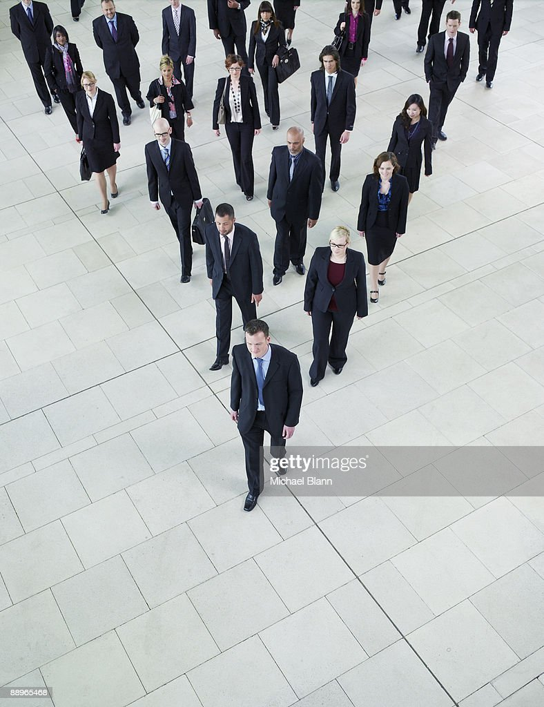 man leading a big group of business people : Stock Photo
