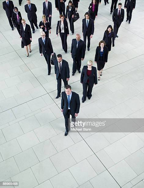 man leading a big group of business people